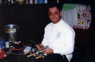 Bob prepares candelabra for AGM (Peter) - 96-0026.jpg